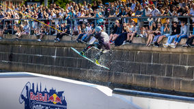 Wakeboard freestyle rider does tricks at competition Royalty Free Stock Images