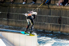 Wakeboard freestyle rider does tricks at competition Royalty Free Stock Image