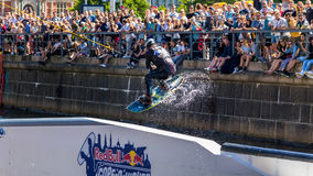 Wakeboard freestyle rider does tricks at competition Stock Photos