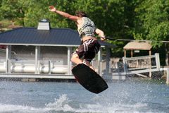 Wakeboard Jump. Young man performing a trick on the wakeboard royalty free stock photo