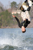 Wakeboard Jump. Teenage boy performing a wakeboard trick Royalty Free Stock Image