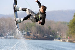 Wakeboard Jump. Teenage boy performing a wakeboard trick Stock Images