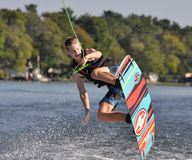 Wakeboard jump over wave stock image