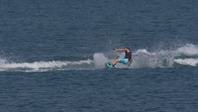 """Wakeboard Man Jump Motorboat. A boy riding wakeboard on wave of motorboat and jumping the wake during the """"Wake Zone Cup"""" on 1 July 2108 in Lake Como stock video footage"""