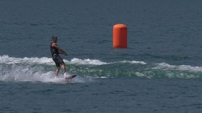 """Wakeboard Man Jump Motorboat. A boy riding wakeboard on wave of motorboat and jumping the wake during the """"Wake Zone Cup"""" on 1 July 2108 in Lake Como stock video"""