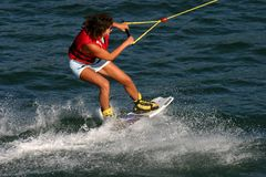 Wakeboard player. Wake board player - girl Stock Image