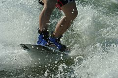 Wakeboard splash -. Young man wakeboarding Royalty Free Stock Photos