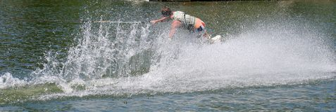 Wakeboard Sport. Teenage boy showing skill on the wakeboard Stock Photos