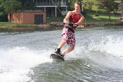 Wakeboard Sport. Teenage boy showing skill on the wakeboard stock photo