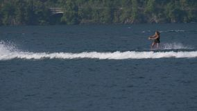 """Wakeboard Woman Jump Motorboat. A girl riding wakeboard on wave of motorboat and jumping the wake during the """"Wake Zone Cup"""" on 1 July 2108 in Lake stock video"""