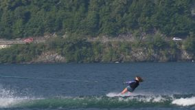 """Wakeboard Woman Jump Motorboat. A girl riding wakeboard on wave of motorboat and jumping the wake during the """"Wake Zone Cup"""" on 1 July 2108 in Lake stock video footage"""
