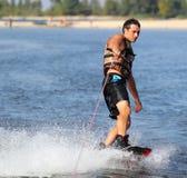 Wakeboarder в заходе солнца Стоковое Фото