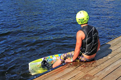 Wakeboarder. On the wooden dais Royalty Free Stock Photography