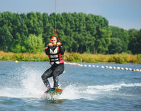Wakeboarder cable towed Stock Photo