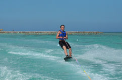Wakeboarder Carving in the Tropical Waters of Aruba. Young guy carving on the tropical waters of Aruba Stock Image