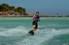 Wakeboarder Carving and Turning on a Wakeboard in Aruba. Wakeboarder carving in the tropical ocean waters of Aruba Stock Photos