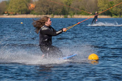Wakeboarder is doing her trick at Wakeboard track. Stock Photos
