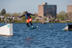 Wakeboarder is doing his trick at Wakeboard track. Stock Photo