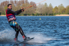 Wakeboarder is doing his trick at Wakeboard track. Stock Images