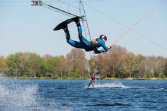 Wakeboarder is doing his trick at Wakeboard track. stock photography
