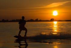 Wakeboarder making tricks on sunset Stock Image