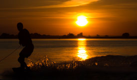 Wakeboarder making tricks on sunset Royalty Free Stock Images