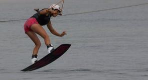 Wakeboarder making tricks on sunset. Wakeboarding Royalty Free Stock Image
