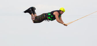 Wakeboarder making tricks on sunset. Wakeboarding Royalty Free Stock Photos