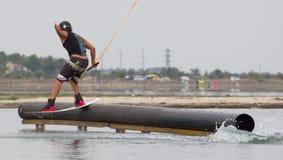 Wakeboarder making tricks on sunset. Wakeboarding Royalty Free Stock Photo