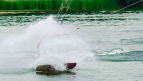 Wakeboarder making wave Stock Image