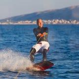 Wakeboarder nel tramonto Fotografie Stock