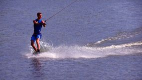Wakeboarder rides a board Stock Image