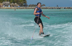 Wakeboarder Riding with Only One Hand in Aruba Stock Images