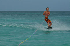 Wakeboarder Riding a Wakeboard off the Coast of Aruba Royalty Free Stock Images