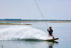 Wakeboarder shows extreme trick Stock Photos