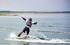 Wakeboarder shows extreme trick Stock Images