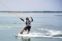 Wakeboarder shows extreme trick Royalty Free Stock Photo