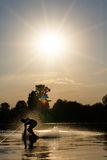 Wakeboarder silhouette against the sunset Royalty Free Stock Images