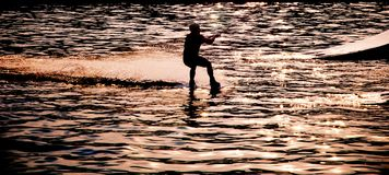 Wakeboarder silhouette in backlight stock image
