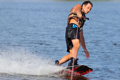 Wakeboarder  in sunset. Royalty Free Stock Photos