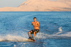 Wakeboarder in sunset. Stock Photos