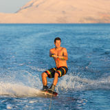 Wakeboarder in sunset. Royalty Free Stock Photography