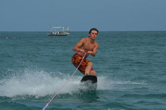 Wakeboarder in a Tight Crouch Off the Coast of Aruba Royalty Free Stock Image