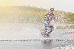 Wakeboarder trains in the lake at sunny day. Space for text stock photos