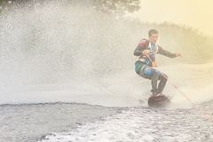 Wakeboarder trains in the lake at sunny day. Space for text royalty free stock photos