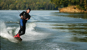Wakeboarding. Man Wakeboarding on the lake Stock Image