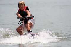 Wakeboarding Boy. Young boy wakeboarding on the lake Stock Photography