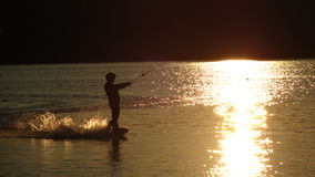 Wakeboarding no por do sol Imagem de Stock Royalty Free