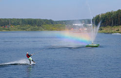 Wakeboarding with the rainbow Stock Image