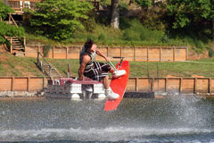 Wakeboarding Sport. Young man performing a trick on the wakeboard stock photos